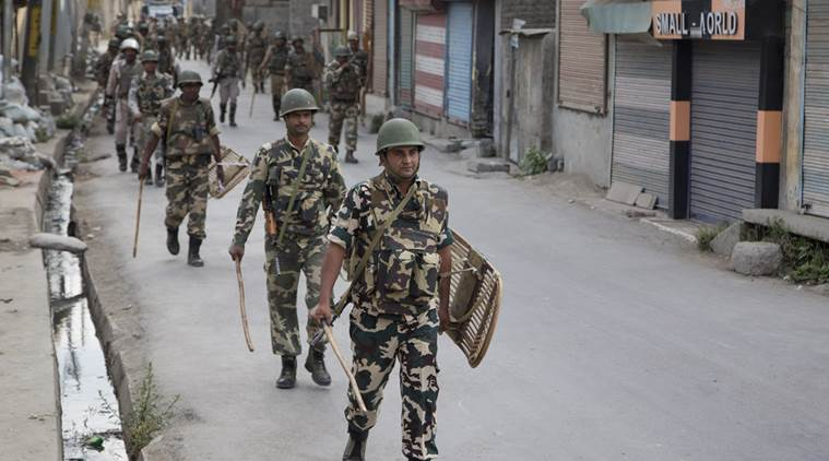 Soldiers parading the streets. Freedom in Kashmir? (Source: Indian Express)